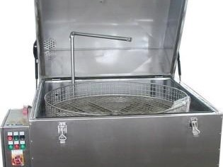 front view of a top loading spray washer